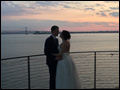 bride and groom at the sunset on Long Island as their wedding is winding down