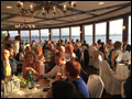 guests are seated for the wedding banquet at a waterfront hall for a catered buffet style dinner