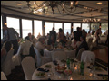Wedding guests enjoying good food and conversation at a catered Long Island wedding at The Merchant Marine Academy