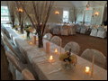 candle lit hall ready to receive wedding guests