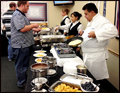 crepe station at a catered corporate breakfast with crepes being cooked right in front of you