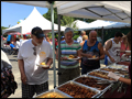 people getting our delicious catered food at a company bbq