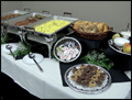 catered breakfast buffet with scrambled eggs, bacon and potatoes
