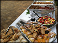 catered breakfast buffet with mini pastries, muffins and fresh fruit