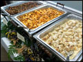 catered buffet line with portabella chicken, penne vodka and chicken meatballs in gorgonzola sauce