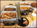 chafing dishes with catered appetizers at a corporate event