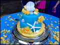 beach themed turquoise wedding cake decorated with sea shells and yellow roses