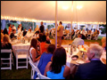 Long Island wedding party at a lit party tent