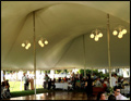 domed wedding tent lit with chandeliers for a catered Long Island wedding