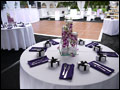 Long Island catered wedding table setup with orchids, purple and white linens and lounge decor