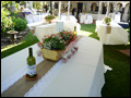 tables set in white linens for a Tuscan style catered wedding