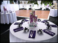 li wedding catering in a white party tent with a black astro turf floor and wooden dance floor