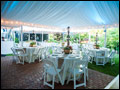 beautiful lined party tent at a Tuscan style catered backyard wedding