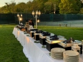 sun is setting over a buffet line at a Long Island wedding