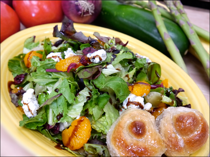 Mesclun salad with cranberries and tangerines, served with our home made garlic knots
